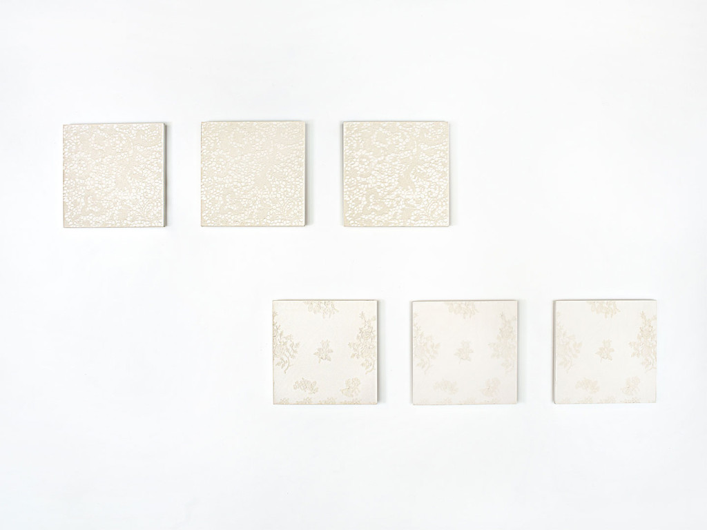 6 concrete tiles with delicate reliefs of lace and florals creates 2 series with 3 tiles each of modern wall art.