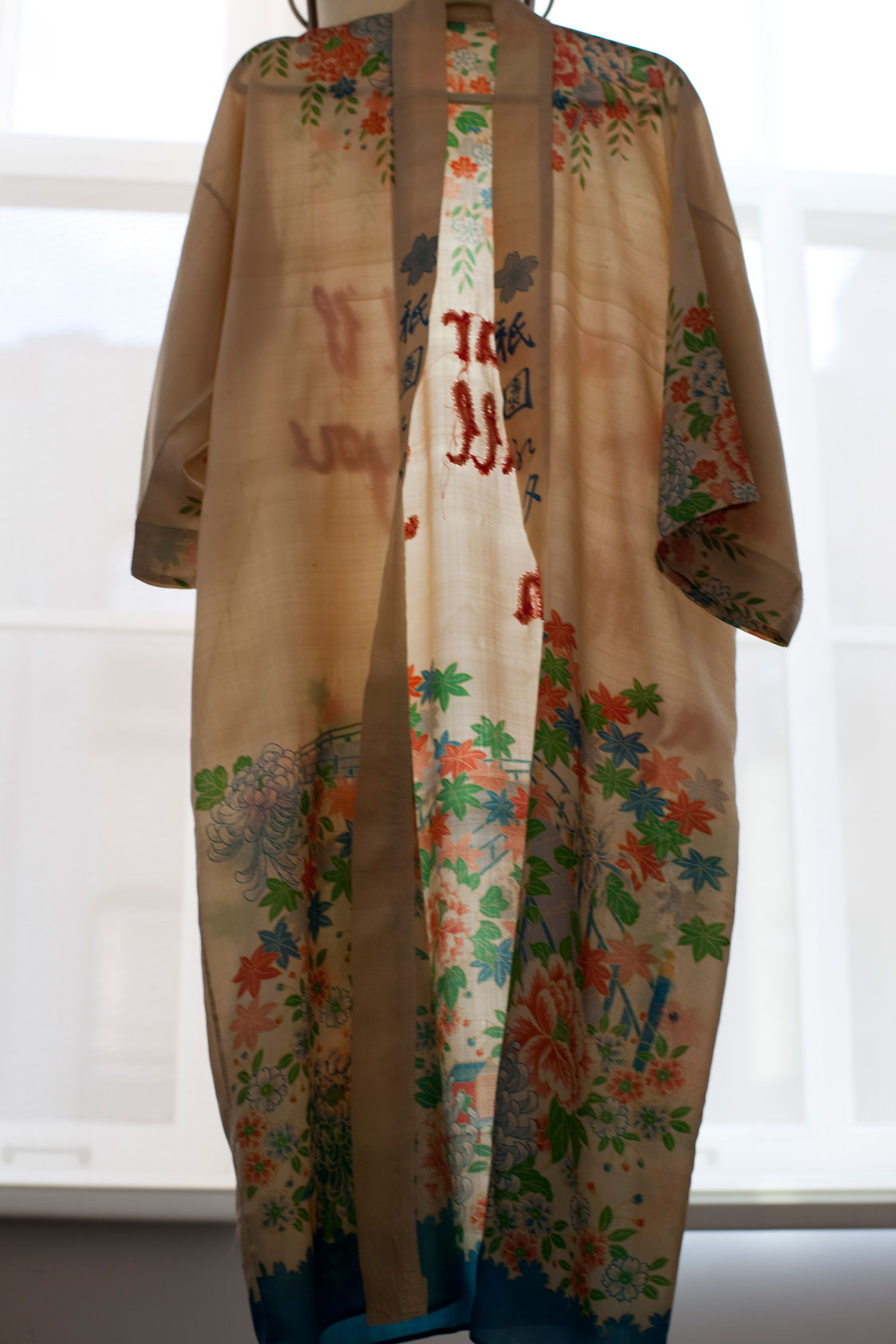 Japanese vintage robe embroidered as feminist art.