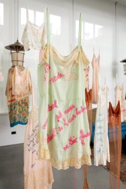 Pop art as vintage lingerie with embroidered 90's rap lyrics.