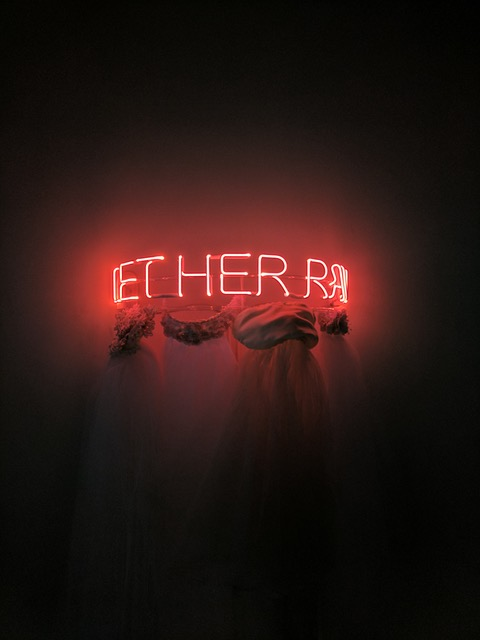 Let Her Rave neon artwork by Zoe Buckman uses wedding veils