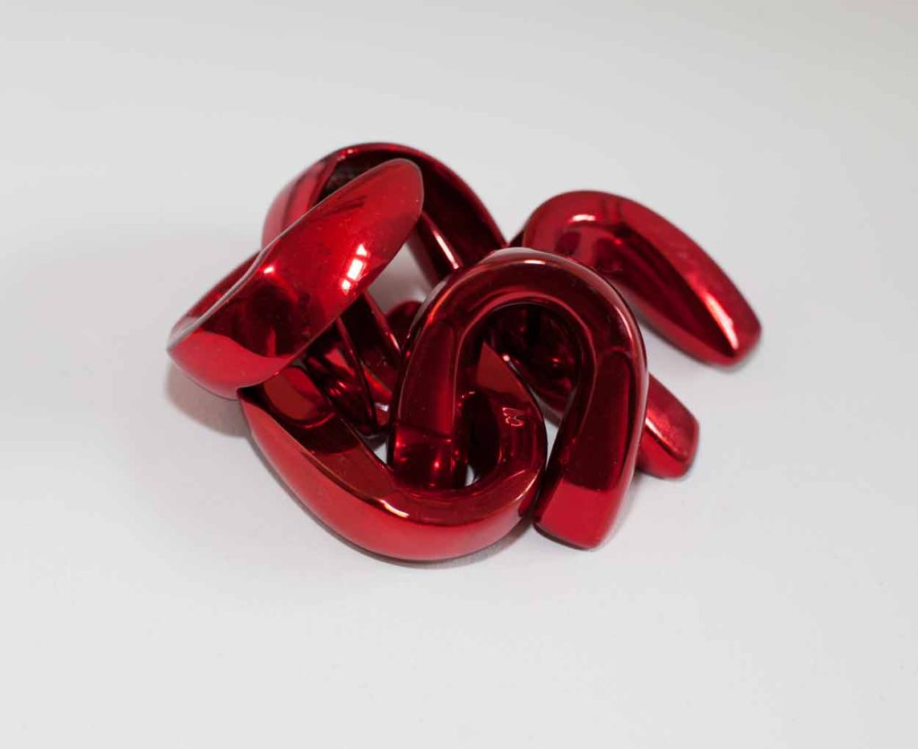 Cherry red boxing mouth guards as feminist art sculpture