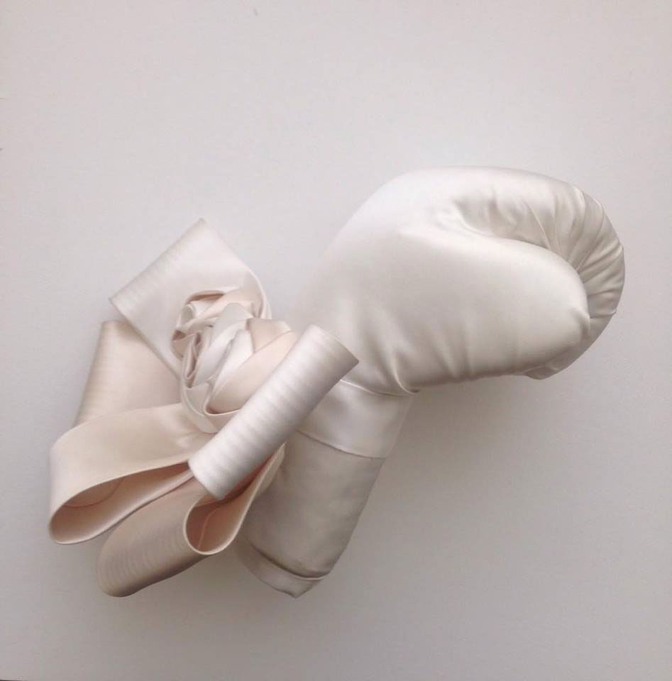 Zoe Buckman's wedding dress boxing glove sculpture with bow and rosettes