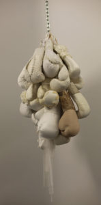 Cluster of boxing gloves with wedding dress details are sculpture by Zoe Buckman