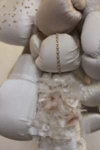 Boxing gloves marry wedding dresses in artist Zoe Buckman's sculpture