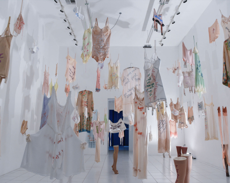 Art installation by Zoe Buckman of hanging embroidered vintage lingerie