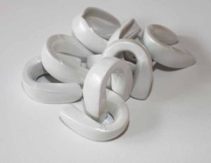 Pearl white powder coated boxing mouth guards as feminist sculpture